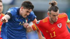 Alessandro Bastoni of Italy challenges Gareth Bale