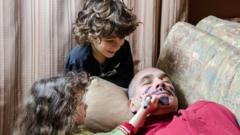 kids-drawing-moustache-on-dad.