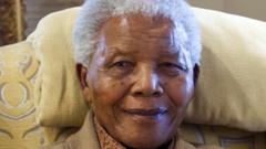 Former South African President Nelson Mandela is pictured during a visit by former US president on July 17, 2012 at his home in Qunu, Eastern Cape,