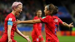 Mallory-Pugh-of-the-USA-celebrates-with-teammate-Megan-Rapinoe.