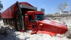 A truck is buried in ice after a heavy storm of rain and hail which affected some areas of the city Guadalajara