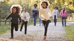 GIRLS-RUNNING-OUTSIDE-LEAVES.