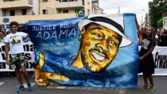 Protesters with a Justice for Adama banner