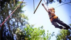 Boy in harness grabs swing