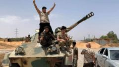 Libyan soldiers capture a tank from the warlord Gen Haftar's militias in Tripoli on 4 June 2020.