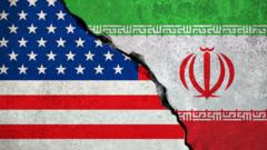 Graphic showing US and Iranian flags with crack down the middle