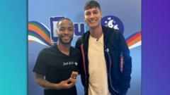 Blue-Peter-presenter-Richie-Driss-and-Raheem-Sterling.