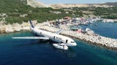 A huge airplane has been pulled out to sea and sunk to become an artificial reef and diving attraction.
