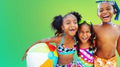 children-in-beachwear-googles-with-beach-ball
