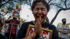 Young protester cries at ceremony to honour victims of crackdown