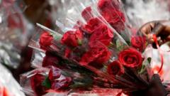 Bouquets of roses are for sale for Valentine's Day at a flower shop