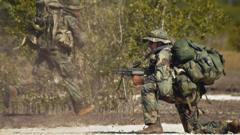 US marines take part in the US-Kenyan joint military exercises near the Somali border in Lamu, Kenya, 12 February 2002