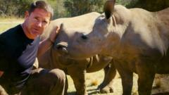 Steve-Backshall-with-rhinos
