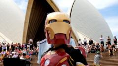 Iron Boy strikes a pose in front of the Opera House