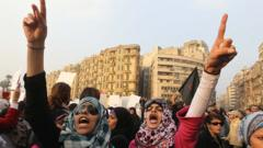 Women shout slogans against the Egyptian security forces in Cairo in December 2013