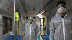 Tehran Municipality workers clean a metro train to avoid the spread of the COVID-19 illness on February 26, 2020.