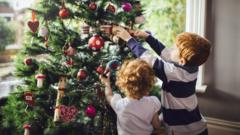 Children taking down Christmas decorations