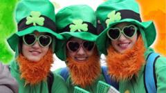 three-women-dress-up-for-st-particks-day-in-big-green-hats.