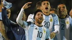 The Argentinean team jump up and down behind Messi, in their blue and white striped tops.