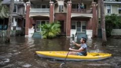 Justin Hand navigates storm surge flood waters from Hurricane Irma along the St. Johns River on Sept. 11, 2017 in Jacksonville, Florida