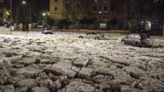 Cars stranded in thick snow and hail in Italy.