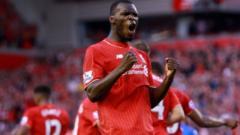 Christian Benteke celebrates scoring for Liverpool against Bournemouth