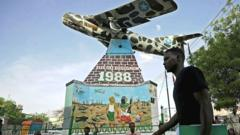 A man walking past a war memorial in Hargeisa, Somaliland
