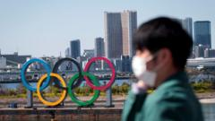 olympic-rings-and-man-in-mask.