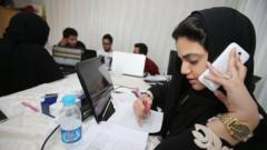 Members of the communication staff for the campagin of a female candiate for the upcoming Saudi municipal elections work hard on contacting and talking to electors