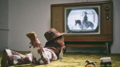 kid-in-cowboy-costume-watching-tv.