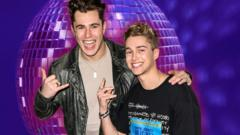 aj-pritchard-and-brother-curtis-in-front-of-disco-ball