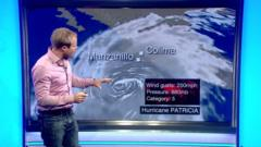 Simon King at weather map