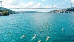 Competitors race across the Bosphorus