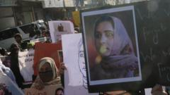 Supporters of Baloch political activist Karima Baloch hold her pictures during a rally to mourn her killing, in Quetta, the provincial capital of Balochistan province, Pakistan, 23 December 2020.