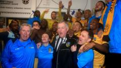 Sutton United's players celebrate after beating Leeds United in the FA Cup