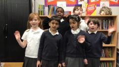 six-school-children-wave-to-camera