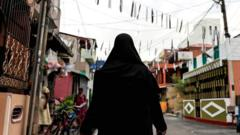 2019 File photo of a Muslim woman wearing a hijab walking through a street near St Anthony's Shrine in Colombo