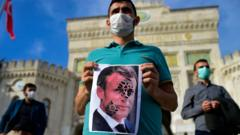 A Turkish man holds a poster of Emmanuel Macron during an anti-France protest
