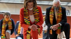 Democrats in kente scarves kneel in moment of silence for George Floyd