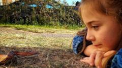 hollie-with-corn-snake-in-the-grass