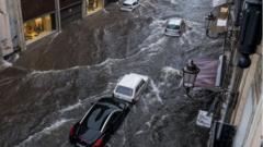 The Via Etnea turned into a river due to heavy rainfall