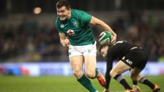 Jacob Stockdale runs with the ball