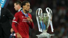 Virgil Van Djik with Champions League trophy