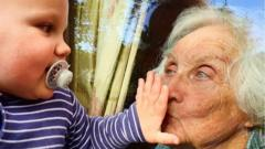 baby-and-grandma-at-window.