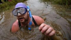 A competitor takes part in the 30th World Bog Snorkelling Championships in Waen Rhydd peat bog at Llanwrtyd Wells, south Wales on August 30, 2015. Entrants must negotiate two lengths of a 60-yard trench through the peat bog in the quickest possible time without using any conventional swimming strokes.