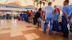 Holiday-makers wait in line at Sharm el-Sheikh airport