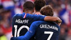 Mbappe and Griezmann hugging one another