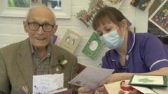 John with carer reading card