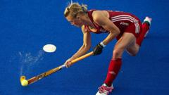 Alex Danson playing hockey for England women's team