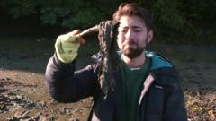 ricky holding a wet wipe